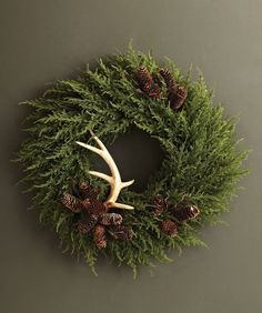 evergreen wreath simply adorned with antlers and pinecones
