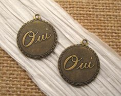 Oui (Yes) Charms in BrassOx from Trinity Brass - 2 Count by beadbarnsupplies on Etsy