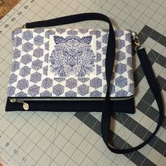 @fabricaddictquilts - Take that, zipper!! I win!  And my cute little fold over zipped clutch with detachable shoulder strap is finished!  I'm so glad I worked the tiger face into the front... #htwipit @hawthornethreads #bengalfabric #etchedfabric #iamsmarterthanazipper
