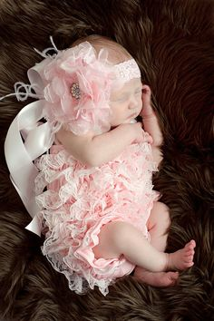 pink lace baby romper.