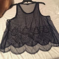Beaded see through blue top It's beaded, think Gastby. Always worn over a tub top or can be worn with just a bra. Fun for paint parties, clubs or if you work in retail because you don't get hot. American Eagle Outfitters Tops Camisoles