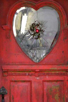Heart window in red door.