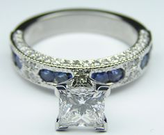 Princess Cut Diamond Vintage Engagement Ring with Blue-Sapphire Accents [except give me a round diamond]