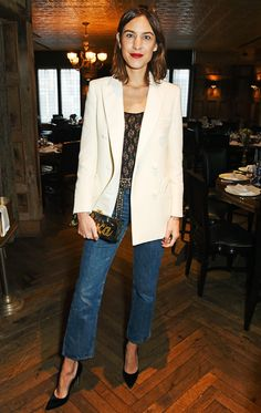 On Alexa Chung: Edie Parker custom clutch. Again and again, Chung brings her look together with a lace top tucked into a pair of blue jeans, topped off with a long blazer and finished with heels. She plays with colors, materials, and silhouette to keep the ensemble looking fresh, occasionally adding in fun accessories.