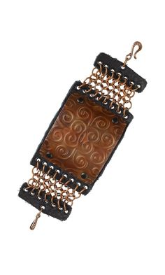 Jewelry Design - Bracelet with Embossed Metal Sheet, Chainmaille and Leather Scrap - Fire Mountain Gems and Beads