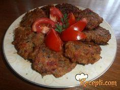 Recept za Zdrave hamburgere. Za spremanje ovog jela neophodno je pripremiti patlidžan, luk, paradajz, peršun, maslinovo ulje, brašno, origano, so, biber.