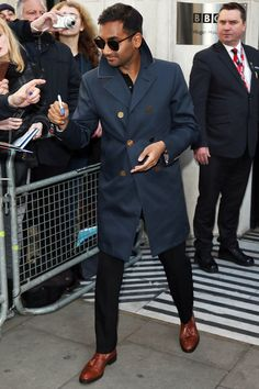 Aziz gets it.  Killin it with the double breasted rain coat.