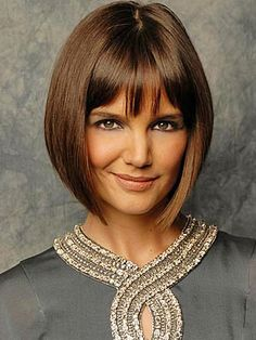 If I liked bangs I'd so do this hairstyle. Oh, and if i could wear my hair parted down the middle. :)