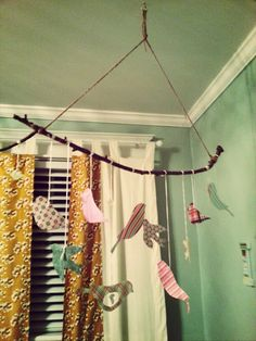 DIY bird mobile - using twine, stick and birds crafted from art paper