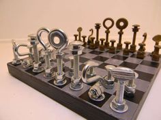 Made from everyday nuts and bolts, the pieces in this chess set perfectly capture the spirit of the game. Though you might be able to dismantle your opponent with a couple of box wrenches. Diy Chess Set, Chess Board Set, Chess Sets, Horseshoe Crafts, Horseshoe Art, Chess Players, Chess Pieces, Strategy Games, Metal Crafts