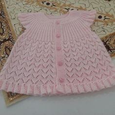 Beautiful dress for baby girls, I wanted to share this with you too. we will be glad when you knitting and share with us.