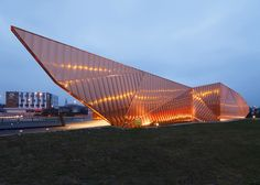 Copper panels give a flame-like appearance to Museum of Fire in Poland.