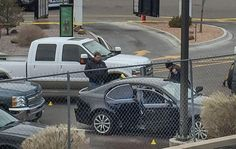 Police search a car involved in a shooting where an officer shot another officer, according to authorities. Police say the shooting happened during an undercover narcotics operation. (Nicole Perez/Albuquerque Journal)