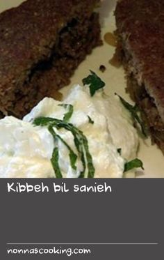 Kibbeh bil sanieh | Syria's national dish of minced meat and burghul is so deeply loved that over the years its fans have found many different ways to prepare it. The secret is using fresh, very finely minced meat. This is carefully spiced then served raw, baked or fried in endlessly varying shapes, often with delicious fillings (that often include more minced meat). This recipe is for a kind of kibbeh sandwich: a layer of cooked, spiced meat and pine nuts is pressed between two layers of… Hake Recipes, Dill Recipes, Yogurt Recipes, Oven Recipes, Baking Recipes, Salad Recipes, Pine Nut Recipes, Mince Recipes, Meat Pies