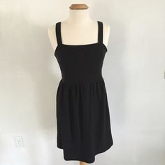 Loft Black Sundress Ann Taylor Loft black sundress with stretch, size Medium. Excellent condition - no rips  holes /stains etc. Very comfy and flattering! LOFT Dresses Mini