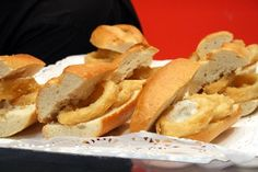 A plate of calamari sandwiches is typical all throughout the Spanish capital, simple yet delicious - one of many great typical foods in Madrid