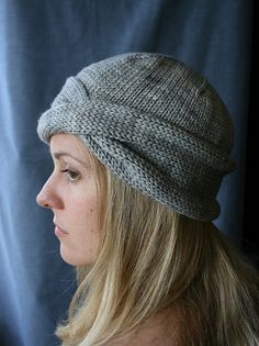 Nola Cloche by Hilary Smith Callis.  Can be worked in bulky or worsted weight yarn.  Side twist can be turned to the front and worn as a turban.  Cute.