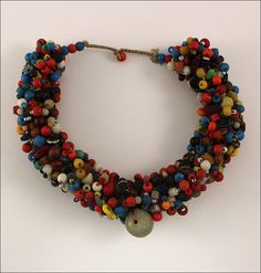 * Old Peul Fulani wedding necklace. This great assortment of colors is worn together by Fulani and Peul women from Mali, traditionally at wedding ceremonies. The vintage glass beads were produced in Europe from the early to the mid 1900s and taken to Africa through the colonial trading routes to be exchanged for local goods. As the largest nomadic group in the world, the Fulani are primarily traders, known for having an immense respect for beauty which is reflected in their jewelry.