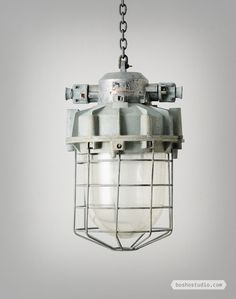 CZECH CAGED FACTORY PENDANT LIGHTS: These extra-large caged factory pendant lights were salvaged from Czech power works.  This style of light fitting is a clear example of function, being a primary goal of this design as it is made to be blast proof .