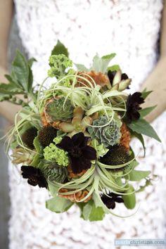 """""""The ingredients: sempervivum rosettes and sedum 'nussbaumerianum' (that's the orange-ish succulent); senecio 'string of pearls'; some pittosporum foliage; echinacea; various tillandsias; a fragrant, lemony geranium; orange cockscomb and chocolate cosmos."""" (The Cutting Garden - Flora Grubb Gardens)"""