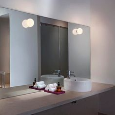 The Glo-Ball light series was created to mimic the glow of a full moon. The unobtrusive Mini Glo-Ball sconces give off a gentle luminosity to your bathroom, while providing a relaxing ambience. 📷: Germano Borrelli #flos #floslighting #design #lightingdesign #bathroomlighting #bathroominspo #italiandesign #interiorinspiration #italianlighting #interiordesign #modernlamp #contemporarylighting #lightingideas #homedecorl Bathroom Lighting Design, Italian Lighting, Ball Lights, Bathroom Inspo, Led, Interior Inspiration, Light Fixtures, Mini, Appliques