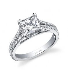 This stunning 18K white gold diamond engagement ring features a 0.75 carat Princess Cut diamond