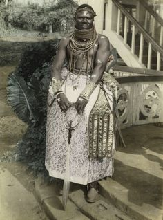 """""""Portrait of Chief Francis Edo Osagie"""" (1960), Benin City, Silver gelatin print with hand-coloring (Chief S. O. Alonge Collection, Eliot Elisofon Photographic Archives)"""