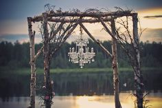 Arbor with chandelier at Teen Time Ranch. Flowers/decor by Love Extravagantly Weddings and photo taken by Live, Love, Laugh Photography.