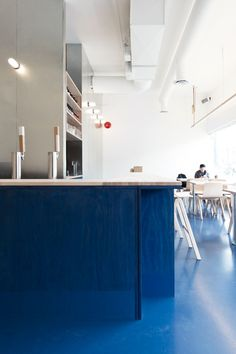 The bright blue plywood and galvanized metal decor of Vancouver's Kin Kao, designed by local architects (and Remodelista favorites) David and Susan Sc Vancouver Restaurants, Blue Cafe, Kitchen Drawing, Interior Architecture, Interior Design, Local Architects, Blue Floor, Hotels, Restaurant Design