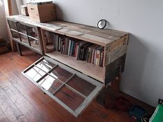 Built out of pallets and old windows. I need one without the legs that are taller and the windows open the other way... Computer desk here i come:)