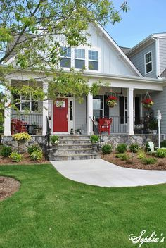 Exterior color scheme- Red door and black shutters with grey siding. I also like the chunky square porch columns Modern Farmhouse Porch, Farmhouse Front Porches, Farmhouse Style, Farmhouse Decor, Country Style, Farmhouse Landscaping, Modern Porch, Modern Rustic, Landscaping Ideas
