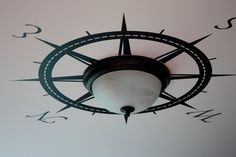 The Yellow Cape Cod: Nautical Boys Room. Compass rose around ceiling light.