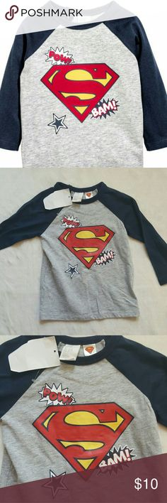 H&M Long-Sleeved Baby Superman Tee Long-sleeved T-shirt in soft cotton jersey with a printed design. Snap fasteners at back of neck. 100% Cotton.  🐳 New with tags!  🐳 Offers/Bundle offers are accepted  🐳 Please check out my other baby items to bundle and save 💲💲💲 🐳 Sorry, no trades  Suggested User / 135+ Items Sold / Top Rated Seller H&M Shirts & Tops Tees - Long Sleeve