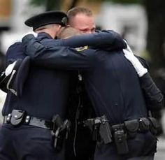A picture contains 1000 words. Police officers weep in Newtown, CT. 12/14/2012  God Bless all those whose lives were forever changed because of one sick individual. And thank God for our police officers and first responders.