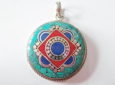 Tibetan turquoise blue red and silver pendant. by SuloJewellery, $20.00 #mandala #turquoise #pendant
