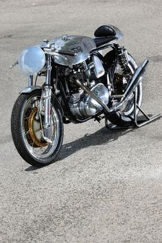 The immaculate lines of the classic English Triton motorcycle: Triumph engine, Norton frame.