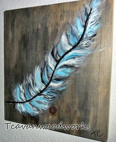 blue feather painting canvas on weather wood. Fine silver glitter accents. The blue feather meaning ~ peace, happiness, mental awareness, being your true self.