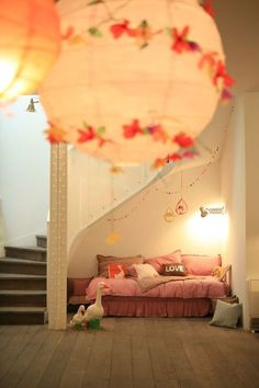 a cozy nook under the stairs would like to do something like this for Bo if I found somewhere to store all my saved clothes not in pink, like harry potter.