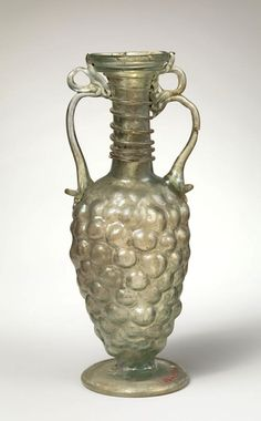 Glass bottle shaped like a bunch of grapes Period: Late Imperial Date: 3rd century A.D. Culture: Roman.