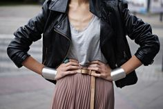 leather and a soft pleated skirt