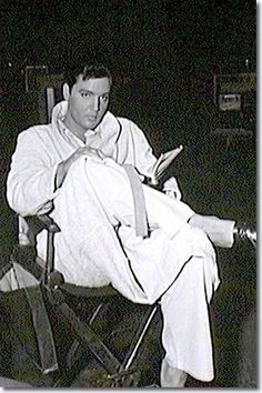 Elvis in his robe relaxing and reading in between scenes of Fun in Acapulco