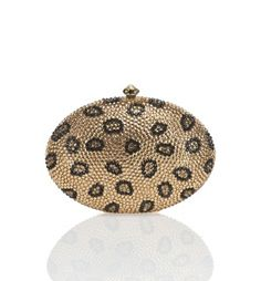 """Crystal rhinestone oval clutch with push clasp closure Includes optional strap Dimensions: 5.5 x 4 x 2 inches Composition: 100% base metal, crystal, vinyl Strap: 23"""" drop, Optional Clasp: Push clasp closure By Natasha; imported."""