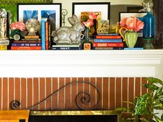 The mantel is prime territory for decorating.  Don't waste this valuable space on a single vase and photo. Instead, create a gallery with framed prints and one-of-a-kind collectibles. An antique chocolate bunny mold not only looks like a fine art sculpture, it's a great conversation piece.