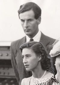 Princess Margaret caught in a candid moment with her true love, Group Captain Peter Townsend.  Despite being a war hero, Townsend's status as a divorcee made him an unacceptable marital choice for Margaret in the eyes of government officials and the Church of England.