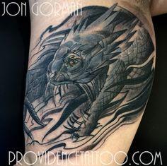 by jon gorman at providence tattoo  #jongorman #providencetattoo #basilisk #tattoo #snake #basilisktattoo #monster