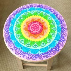 completed flower mandala drawing, in rainbow colors, decorated with white hand-drawn ornaments, diy room decor, on a round wooden stool Mandalas Painting, Mandalas Drawing, Painted Stools, Wooden Stools, Pintura Hippie, Yellow Spray Paint, Cute Diy Room Decor, Wall Decor, Funky Painted Furniture