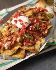 Nachos are the perfect snack for sports fans, as they're easy to make, utensil-free, and always a crowd-pleaser. Our favorite recipes are loaded with all kinds of delicious toppings and are just the thing for game-day entertaining.    Chicken Chili Nachos  Layering the ingredients is the secret behind this knockout nacho recipe. Top tortilla chips with spoonfuls of leftover chicken-and-bean chili, pickled jalapenos, and a combo of Jack and cheddar cheese, then repeat.