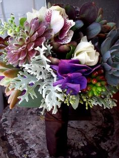 Succulents and a little texture/color (there are silks in this bouquet but everything comes in fresh in the same colors. :) )