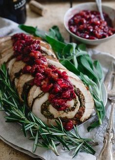This turkey roulade is stuffed with tart cherries, chestnuts and herbs. It's topped with a red wine soaked cherry sauce and makes for a beautiful (and easy!) holiday dish.