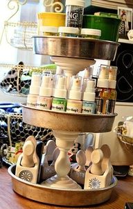 Craft storage made from cake pans and candlesticks.